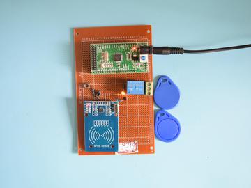 基于STM32单片机的射频RFID酒店刷卡取电开灯系统设计-万用板-电路图+程序+论文94