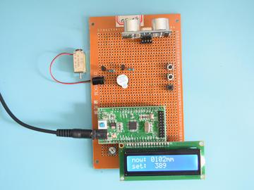 基于STM32单片机的超声波测距倒车雷达防撞报警视力保护设计-万用板-电路图+程序+论文54