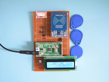 基于STM32单片机的频RFID卡考勤人数计数系统设计-万用板-电路图+程序+论文91