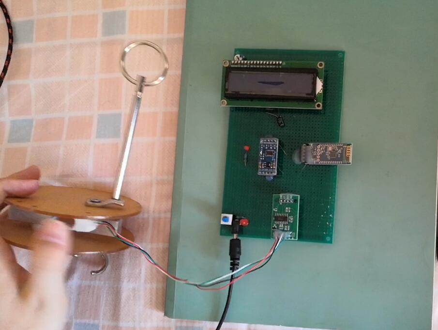 基于STC89C52单片机的智能衣架电路方案设计与实现(含原理图+源代码)