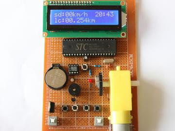 基于51单片机霍尔自行车码表测速系统电路设计方案(原理图+程序)