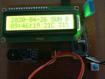 基于STC89C52的温湿度万年历电路方案设计(原理图+程序+仿真文件)