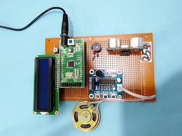 基于STM32单片机的汽车防撞系统设计-LCD1602-超声波-ISD1820-(电路图+程序源码)