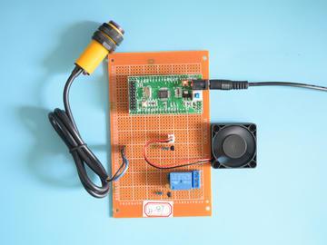 基于STM32单片机的红外干手器/自动小便池系统设计-万用板-电路图+程序+论文87