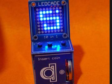 基于atmega328微控制器diy的一个拇指大的游戏街机