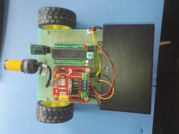 基于51单片机手机蓝牙APP+红外避障控制+风扇吸尘智能车设计-(源码+电路图)